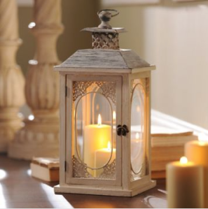 Kirklands Antiqued Cream Lantern (http://www.kirklands.com/product/Antiqued-Cream-Lantern/170814.uts)